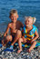 Stock Image : The girl of 3 years, the blonde, and her elder brother on a sea