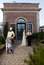 Stock Image : Girls in Victorian outfits in front of old house