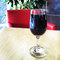 Stock Image : Glass of red wine on the table