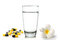 Stock Image : Glass of water pills and Tropical flowers frangipani