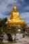 Stock Image : Golden Buddha holding the golden lotus