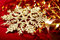 Stock Image : Golden snowflake and tinsel christmas background