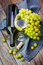 Stock Image : Grape, a bottle and glass of white wine with grape on wooden tab