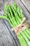 Stock Image : Green asparagus on old wooden plank