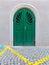 Stock Image : Green Door Cobblestone Street