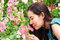 Stock Image : Gril smell the flower