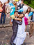 Stock Image : Groom carries his bride over shoulder.