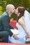 Stock Image : Groom kissing his bride
