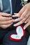 Stock Image : Groom wearing wedding ring on bride finger
