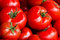Stock Image : Group of fresh tomatoes background. Ripe red tomatoes on a marke