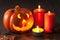 Stock Image : Halloween Jack O Lantern pumpkin spiders candles