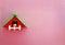 Stock Image : Handmade wood home on pink wall