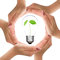 Stock Image : Hands and light bulb with plant inside