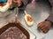 Hands of primary school children putting chocolate on ice cream