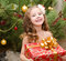 Stock Image : Happy adorable little girl with gift box