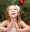 Stock Image : Happy adorable little girl near christmas tree