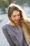 Stock Image : Happy blonde girl in urban background