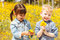 Stock Image : Happy children with yellow flowers.