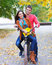 Stock Image : Happy couple with bicycle in autumn park