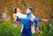 Stock Image : Happy couple having fun in autumn park