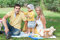 Stock Image : Happy family having picnic in park.