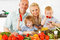 Stock Image : Happy family preparing a healthy dinner at home.