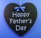 Stock Image : Happy Fathers Day message written on a heart shape black blackboard