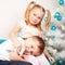Stock Image : Happy kids cuddling near Christmas tree.