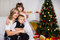 Stock Image : Happy mother and two her children in Christmas