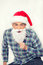 Stock Image : Happy smiling man with shirt and Christmas red hat pretending to