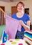 Stock Image : Happy woman ironing