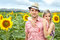 Stock Image : Happy young pair in sunflowers