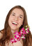 Stock Image : Happy young woman with orchids isolated