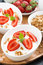 Stock Image : Healthy breakfast - yogurt with fresh strawberries and granola