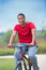 Stock Image : Healthy Looking Young African American Biking Outdoor