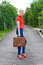 Stock Image : Hitchhiker with suitcase