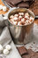 Stock Image : Hot chocolate with marshmallows in a tin mug (closeup)
