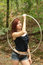 Stock Image : Hula Hoop Woman in the Woods