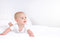Infant child baby girl lying happy smiling on blanket