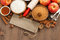 Stock Image : Ingredients for baking apple pie and wooden nameplate, top view