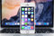 Stock Image : IPhone 5S with IOS 8 stand in the MacBook Pro