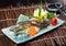 Stock Image : Japanese cuisine. fried fish on the background
