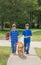 Stock Image : Kids Walking the Dog