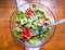 Bowl of salad on wooden table