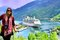Stock Image : Lady with Cruise Ship on Norwegian Fjord