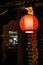 Stock Image : Lantern before wood building