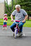 Stock Image : Learning to ride a bike with training wheels