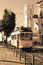 Stock Image : Lisbon tram in the sepia style and church