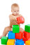 Stock Image : Little baby playing with cubes