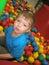 Stock Image : Little boy in balls